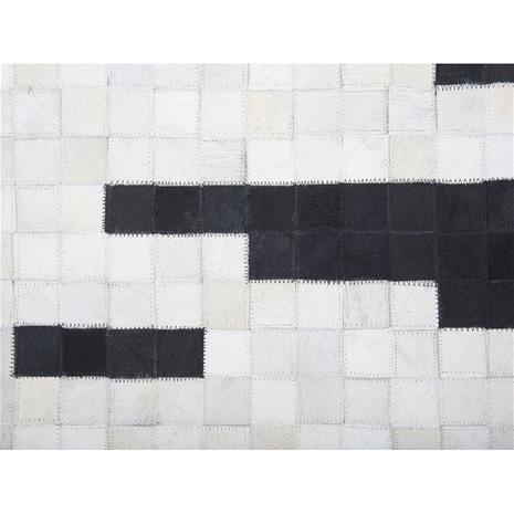 Beliani Nahkainen tilkkumatto 160x230 cm - mustavalkoinen BOLU