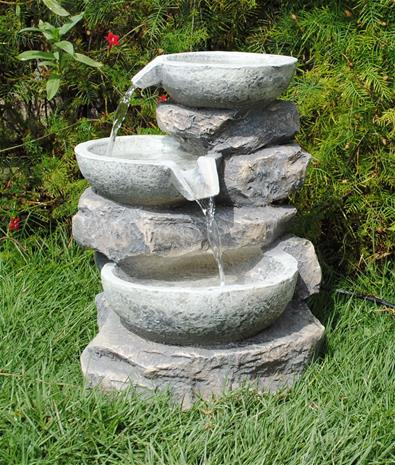 Kivet led-valoilla suihkulähde